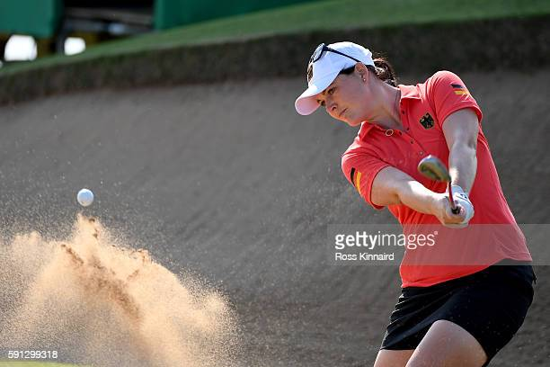 Caroline Masson of Germany Plays a shot from a bunker on the third hole during the First Round of Women's Golf at Olympic Golf Course on Day 12 of...