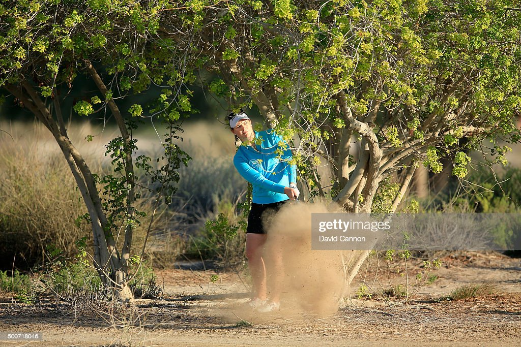 Caroline Masson of Germany plays her fourth shot from some desert scrub on the par 5 10th hole after she had only moved her ball a matter of inches...