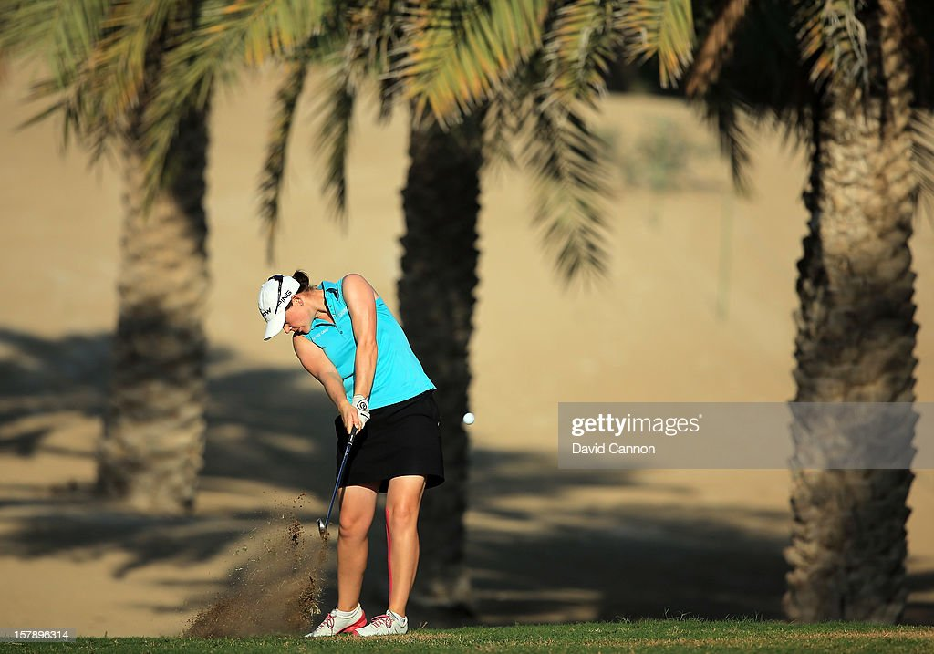 Caroline Masson of Germany plays her second shot at the par 4, 14th hole during the third round of the 2012 Omega Dubai Ladies Masters on the Majilis Course at the Emirates Golf Club on December 7, 2012 in Dubai, United Arab Emirates.
