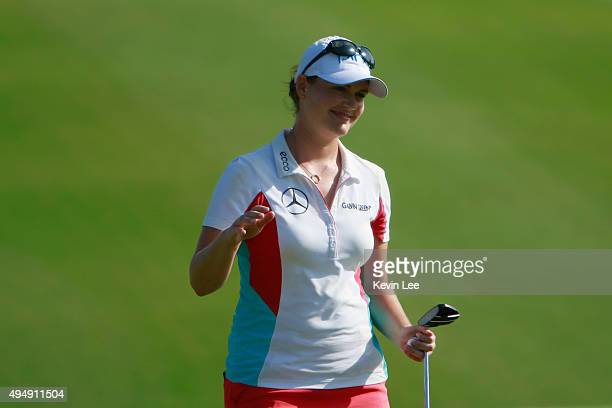Caroline Masson of Germany reacts after her final shot at 18th hole in round 2 on Day 5 of Blue Bay LPGA 2015 at Jian Lake Blue Bay golf course on...