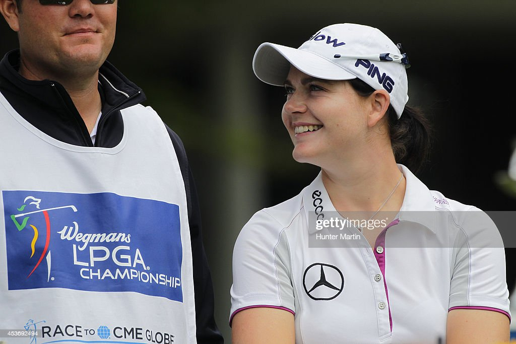 <a gi-track='captionPersonalityLinkClicked' href=/galleries/search?phrase=Caroline+Masson&family=editorial&specificpeople=2259560 ng-click='$event.stopPropagation()'>Caroline Masson</a> of Germany shares a laugh with her caddie on the first tee during the third round of the Wegmans LPGA Championship at Monroe Golf Club on August 16, 2014 in Pittsford, New York.