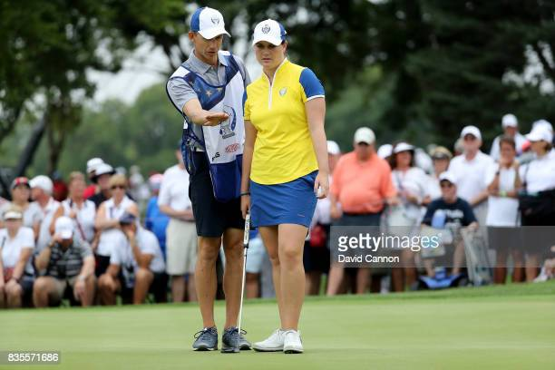 Caroline Masson of Germnay and the European Team lines up a putt on the 14th green in her match with Emily Pedersen against Lexi Thompson and Cristie...