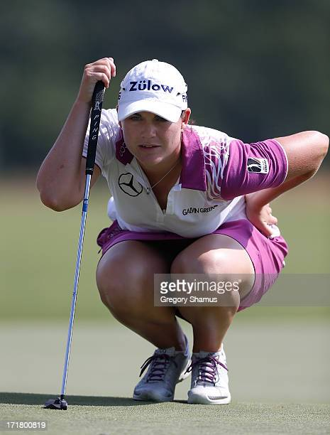 Caroline Masson of Gremany lines up a putt on the 14th green during the second round of the 2013 US Women's Open at Sebonack Golf Club on June 28...