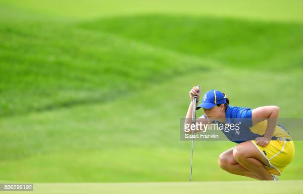 Caroline Masson of Team Europe plays a shot during the final day singles matches of The Solheim Cup at Des Moines Golf and Country Club on August 20...