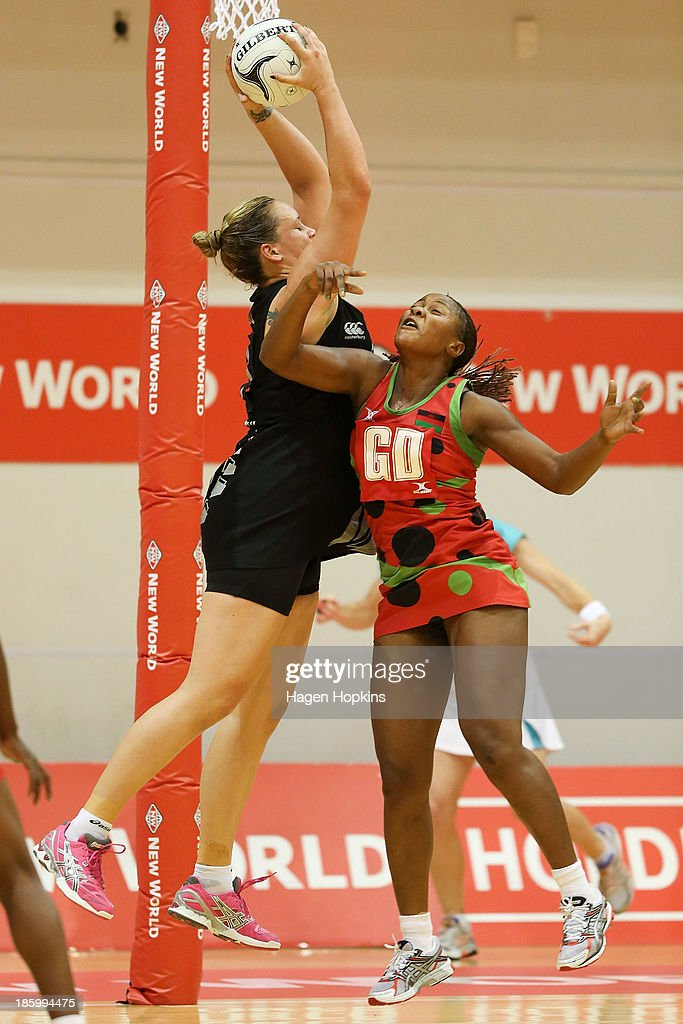 Caroline Mtukule of Malawi and Catherine Latu of New Zealand compete for the ball during the International Test Match between the New Zealand Silver Ferns and the Malawai Queens at Pettigrew Green Arena on October 27, 2013 in Napier, New Zealand.