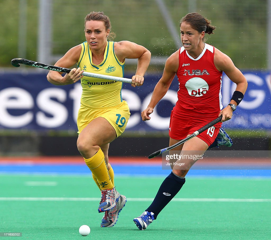 Caroline Nichols of the Unites States and Georgie Parker of Australia sets off after a loose ball during the Investec Hockey World League quarterfinal match between Australia and USA at the Quintin Hogg Memorial Sports Grounds on June 27, 2013 in London, England.