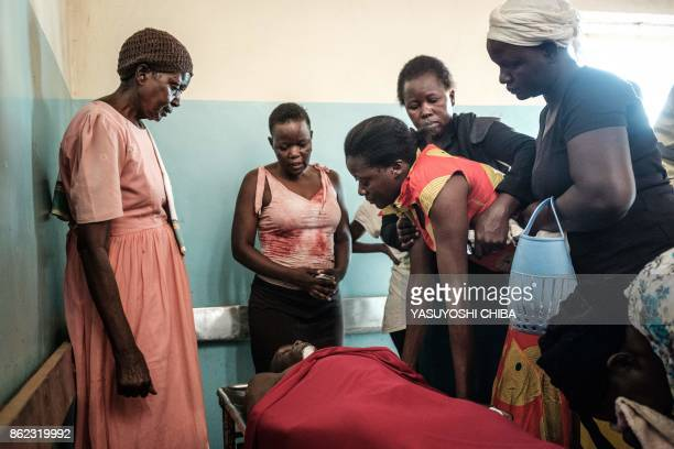 Caroline Okello the mother of 18 yearold Michael Okoth Okello who was allegedly shot by a police officer while he was buying sorbet during the...