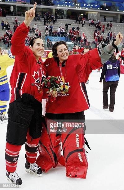 Caroline Ouellette and Charline Labonte both of Canada celebrate their 41 victory over Sweden to win the gold medal in women's ice hockey during Day...