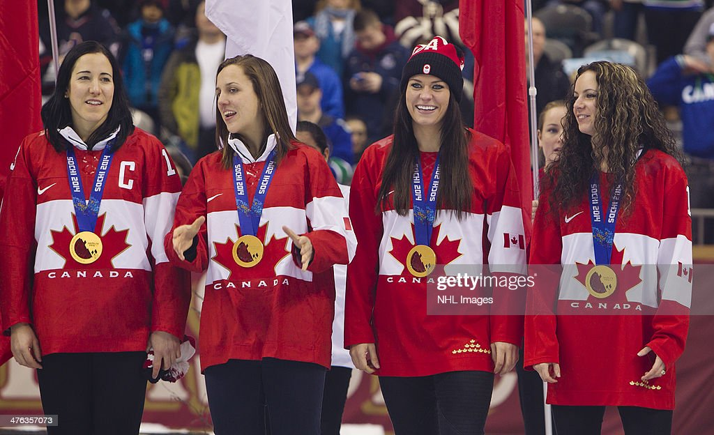 <a gi-track='captionPersonalityLinkClicked' href=/galleries/search?phrase=Caroline+Ouellette&family=editorial&specificpeople=722185 ng-click='$event.stopPropagation()'>Caroline Ouellette</a>, <a gi-track='captionPersonalityLinkClicked' href=/galleries/search?phrase=Lauriane+Rougeau&family=editorial&specificpeople=10857254 ng-click='$event.stopPropagation()'>Lauriane Rougeau</a>, <a gi-track='captionPersonalityLinkClicked' href=/galleries/search?phrase=Natalie+Spooner&family=editorial&specificpeople=10806684 ng-click='$event.stopPropagation()'>Natalie Spooner</a> and <a gi-track='captionPersonalityLinkClicked' href=/galleries/search?phrase=Shannon+Szabados&family=editorial&specificpeople=6221604 ng-click='$event.stopPropagation()'>Shannon Szabados</a> members of the 2014 Canadian Olympic Women's gold medal hockey team are introduced prior to the 2014 Tim Hortons Heritage Classic between the Ottawa Senators and the Vancouver Canucks at BC Place on March 2, 2014 in Vancouver, B.C., Canada.