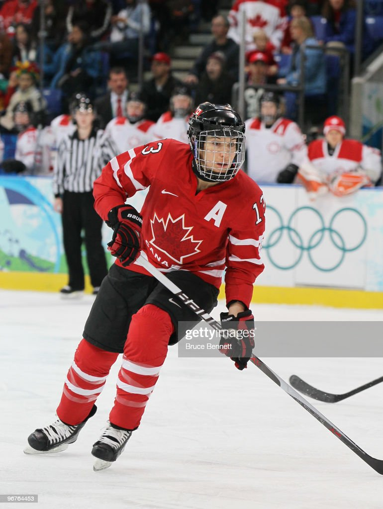<a gi-track='captionPersonalityLinkClicked' href=/galleries/search?phrase=Caroline+Ouellette&family=editorial&specificpeople=722185 ng-click='$event.stopPropagation()'>Caroline Ouellette</a> #13 of Canada in action during the Women's preliminary game between Switzerland and Canada on day 4 of the Vancouver 2010 Winter Olympics at the UBC Thunderbird Arena on February 15, 2010 in Vancouver, Canada.