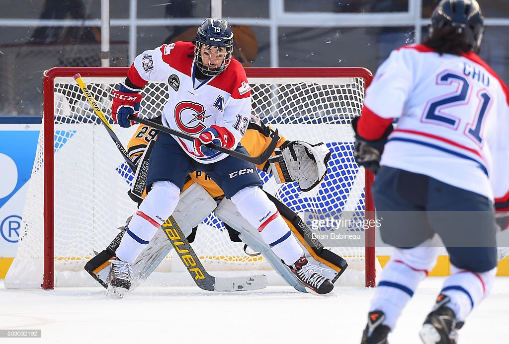 <a gi-track='captionPersonalityLinkClicked' href=/galleries/search?phrase=Caroline+Ouellette&family=editorial&specificpeople=722185 ng-click='$event.stopPropagation()'>Caroline Ouellette</a> #13 of Les Canadiennes looks to deflect the shot on net during the Women's Classic Hockey Game as part of the 2016 Bridgestone NHL Classic at Gillette Stadium on December 31, 2015 in Foxboro, Massachusetts. The 2016 Bridgestone NHL Winter Classic will take place on New Year's Day with the Montreal Canadiens playing the Boston Bruins.
