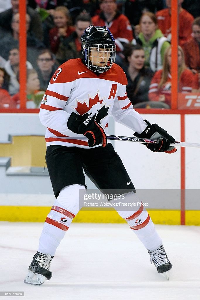 <a gi-track='captionPersonalityLinkClicked' href=/galleries/search?phrase=Caroline+Ouellette&family=editorial&specificpeople=722185 ng-click='$event.stopPropagation()'>Caroline Ouellette</a> #13 of Team Canada skates during the IIHF Womens World Championship Semi-Final game against Team Russia at Scotiabank Place on April 8, 2013 in Ottawa, Ontario, Canada. Team Canada defeated Team Russia 8-1.