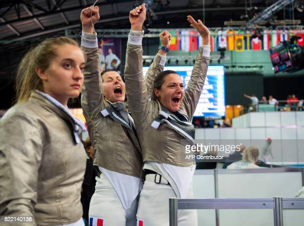 Caroline Queroli Cecilia Berder and Charlotte Lembach of France celebrate after winning their qualification against the team of Ukraine during the...