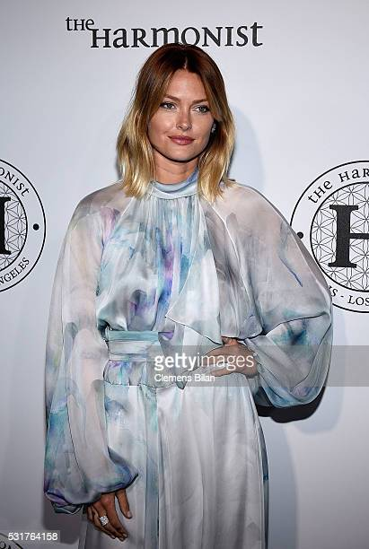 Caroline Receveur attends The Harmonist Cocktail Party during The 69th Annual Cannes Film Festival at Plage du Grand Hyatt on May 16 2016 in Cannes