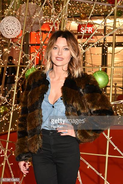 Caroline Receveur pose with lit Xmas tree during Caroline Receveur Launches 'la Christmas Lights at La Canopee des Halles on November 16 2016 in...