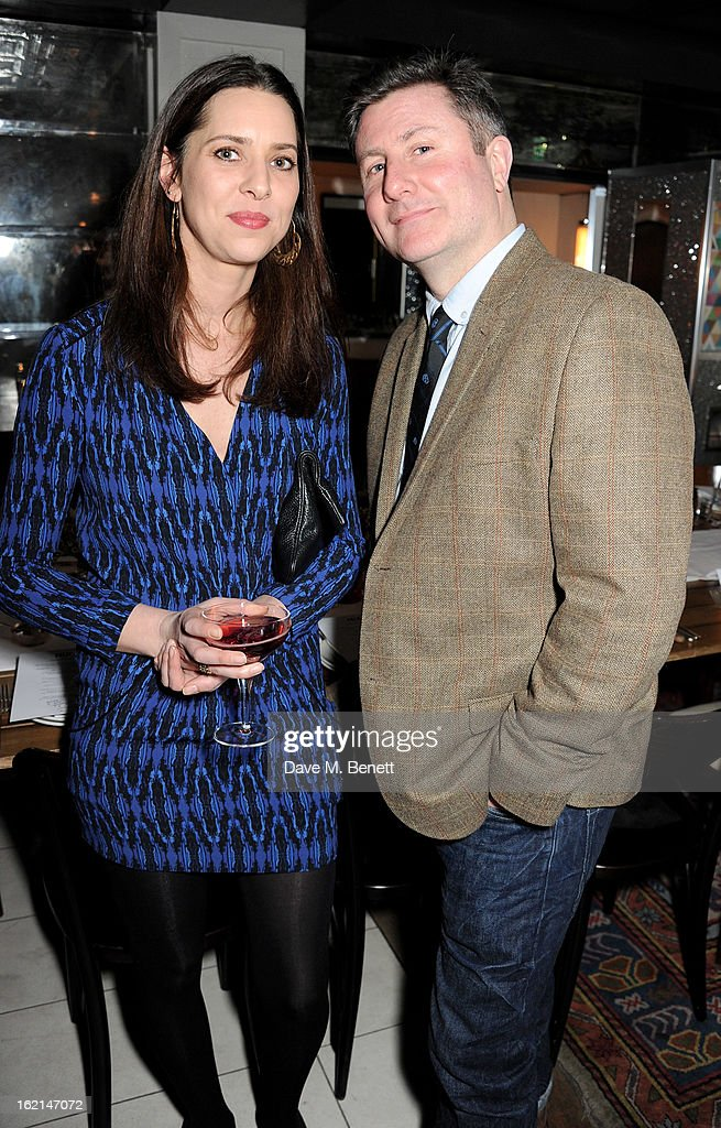 Caroline Ridley (L) and Ben Cooper attend as Nick Grimshaw hosts his first annual award season dinner at Hix, in association with Philips Sound, on February 19, 2013 in London, England.