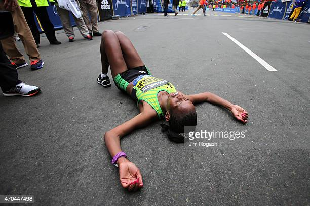 Caroline Rotich of Kenya lies on the road after winning the running of the 119th Boston Marathon on April 20 2015 in Boston Massachusetts