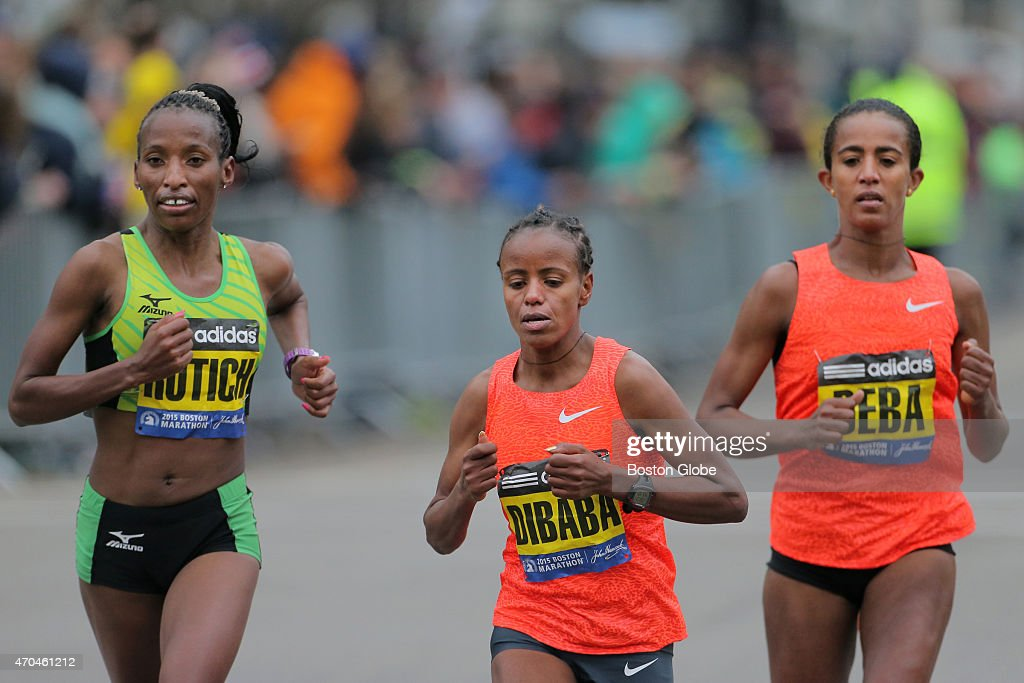 <a gi-track='captionPersonalityLinkClicked' href=/galleries/search?phrase=Caroline+Rotich&family=editorial&specificpeople=14407354 ng-click='$event.stopPropagation()'>Caroline Rotich</a>, of Kenya, <a gi-track='captionPersonalityLinkClicked' href=/galleries/search?phrase=Mare+Dibaba&family=editorial&specificpeople=9614285 ng-click='$event.stopPropagation()'>Mare Dibaba</a>, of Ethiopia, and Buzunesh Deba, of Ethiopia, duel over the final mile during the 119th Boston Marathon.