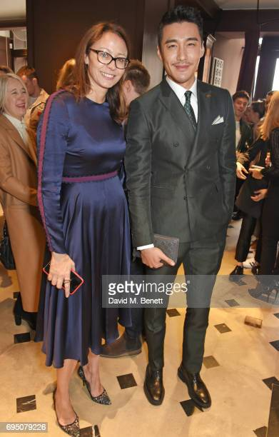 Caroline Rush and Hu Bing attend a breakfast hosted by Christopher Bailey Dame Natalie Massenet and Dylan Jones in celebration of London Fashion Week...