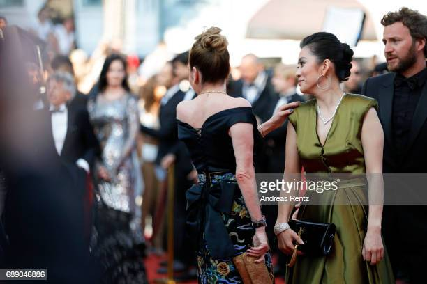 Caroline Scheufele and a guest attend the 'Based On A True Story' screening during the 70th annual Cannes Film Festival at Palais des Festivals on...