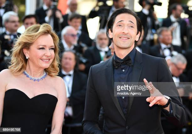 Caroline Scheufele and Adrien Brody arrive for the Closing Awards Ceremony of the 70th annual Cannes Film Festival in Cannes France on May 28 2017