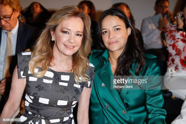 Caroline Scheufele and Michelle Rodriguez attend the Ralph Russo Haute Couture Fall/Winter 20172018 show as part of Haute Couture Paris Fashion Week...