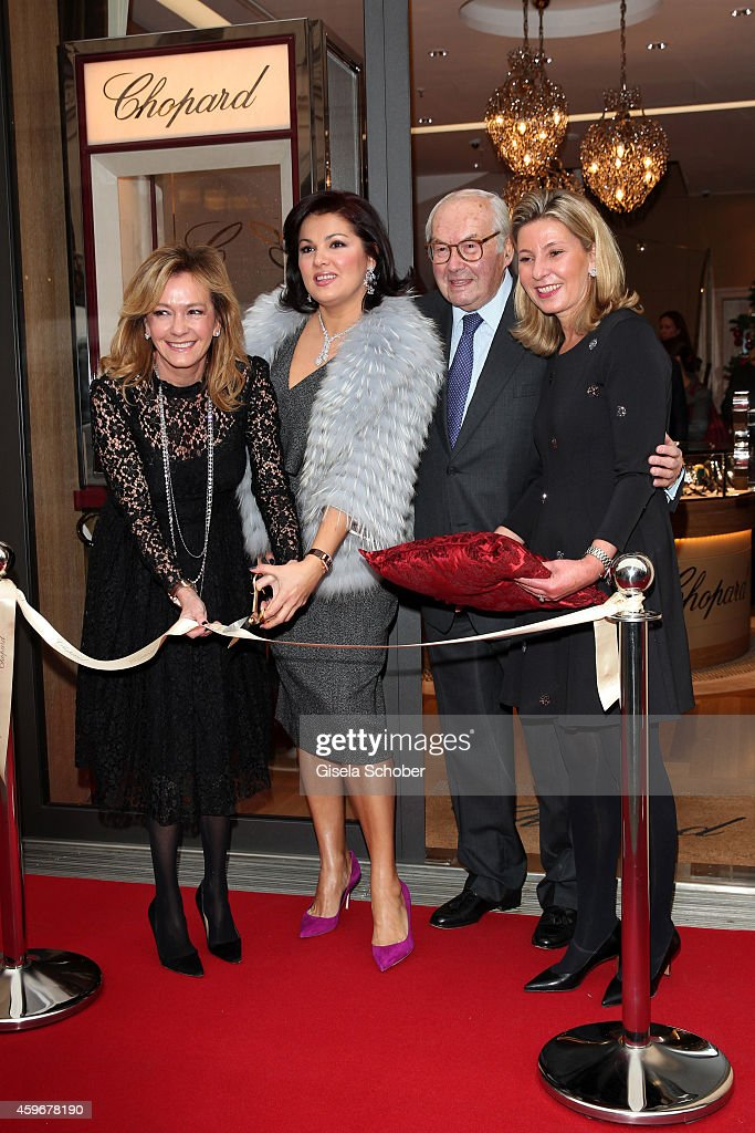 Caroline Scheufele, <a gi-track='captionPersonalityLinkClicked' href=/galleries/search?phrase=Anna+Netrebko&family=editorial&specificpeople=732328 ng-click='$event.stopPropagation()'>Anna Netrebko</a>, Karl-Friedrich Scheufele and boutique director Birgit Lauer pose during the Chopard Boutique re-opening on November 28, 2014 in Munich, Germany.