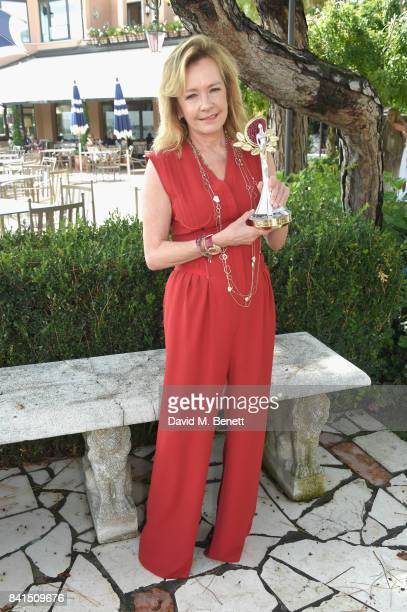 Caroline Scheufele poses with the Green Carpet Fashion Award as she attends an intimate lunch to announce Chopard as partner for The Green Carpet...
