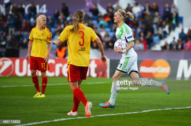 Caroline Seger and Whitney Engen of Tyreso FF look on as Alexandra Popp of VfL Wolfsburg celebrates as she scores their first goal during the UEFA...