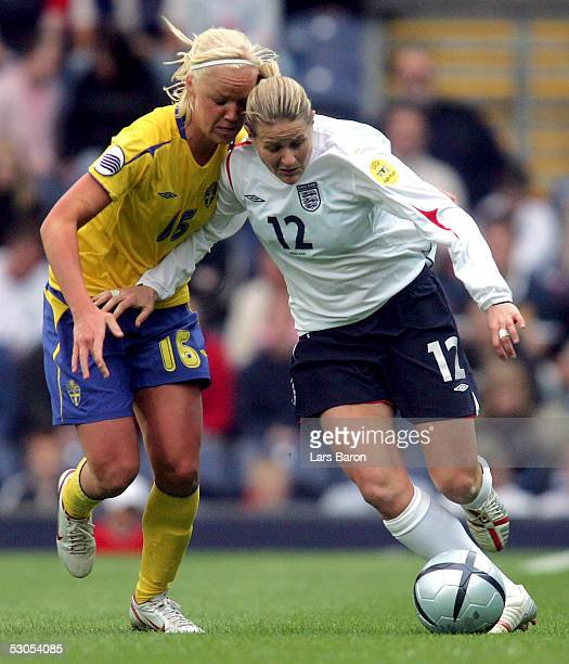Caroline Seger from Sweden challenges Kelly Smith from England for the ball during the UEFA Women's EURO 2005 match between England and Sweden on...