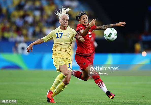 Caroline Seger of Sweden and Dzsenifer Marozsan of Germany challenge for the ball during the Women's Olympic Gold Medal match between Sweden and...