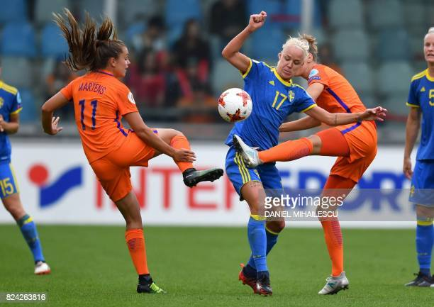Caroline Seger of Sweden fights for the ball during the UEFA Womens Euro 2017 football match between the Netherlands and Sweden at the De Vijverbeg...