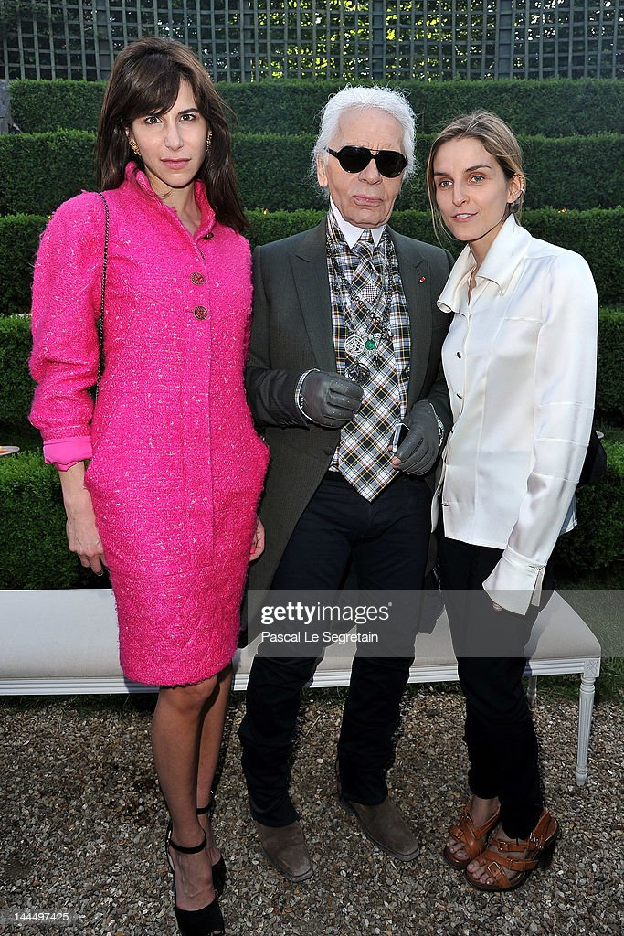 <a gi-track='captionPersonalityLinkClicked' href=/galleries/search?phrase=Caroline+Sieber&family=editorial&specificpeople=3364626 ng-click='$event.stopPropagation()'>Caroline Sieber</a>, Karl Lagerfeld and <a gi-track='captionPersonalityLinkClicked' href=/galleries/search?phrase=Gaia+Repossi&family=editorial&specificpeople=4496699 ng-click='$event.stopPropagation()'>Gaia Repossi</a> pose during the Chanel 2012/13 Cruise Collection at Chateau de Versailles on May 14, 2012 in Versailles, France.