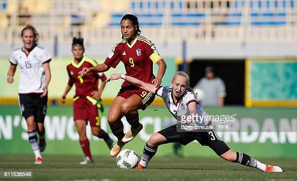 EPTEMBER 30 Caroline Siems of Germany challenges Deyna Castellanos of Venezuela during the FIFA U17 Women's World Cup Group B match between Venezuela...