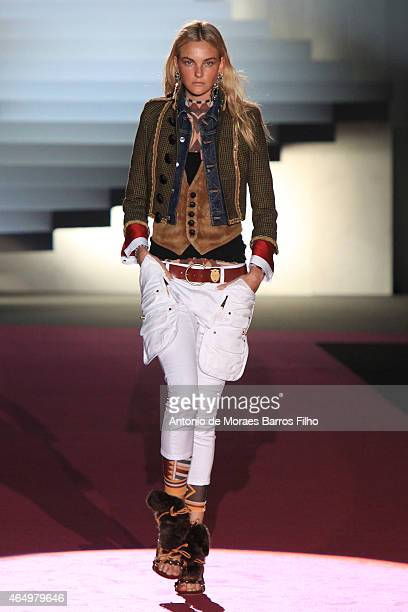 Caroline Trentini walks the runway at the Dsquared2 show during the Milan Fashion Week Autumn/Winter 2015 on March 2 2015 in Milan Italy