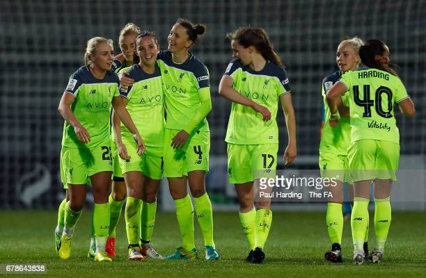 Caroline Weir of Liverpool Ladies celebrates as she scores their third goal with team mates during the WSL 1 match between Arsenal Ladies and...