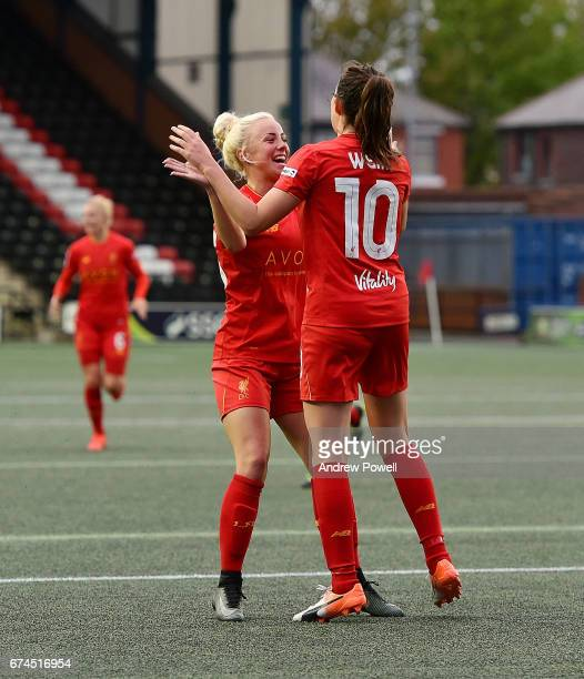 Caroline Weir of Liverpool Ladies celebrates with team mate Ashley Hodson after scoring the thrid during a Women's Super League match between...