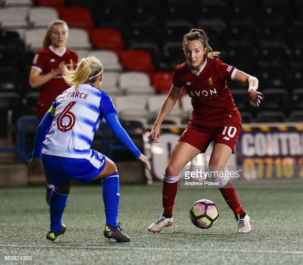 Caroline Weir of Liverpool Ladies competes with Kirsty Pearce of Reading FC Women during the Women's Super League match between Liverpool Ladies and...