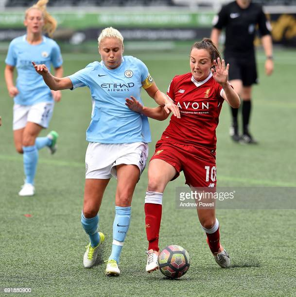 Caroline Weir of Liverpool Ladies competes with Steph Houghton of Manchester City Women during a WSL 1 match between Liverpool Ladies and Manchester...