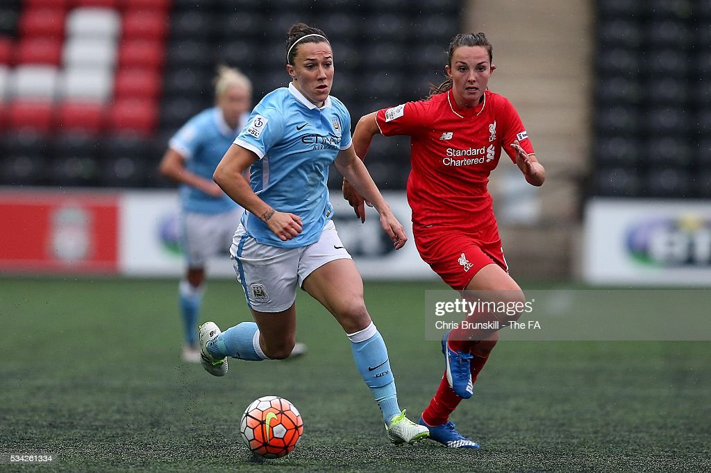 Caroline Weir of Liverpool Ladies FC in action with <a gi-track='captionPersonalityLinkClicked' href=/galleries/search?phrase=Lucy+Bronze&family=editorial&specificpeople=5584928 ng-click='$event.stopPropagation()'>Lucy Bronze</a> of Manchester City Women during the FA WSL match between Liverpool Ladies FC and Manchester City Women at the Halton Stadium on May 25, 2016 in Widnes, England.