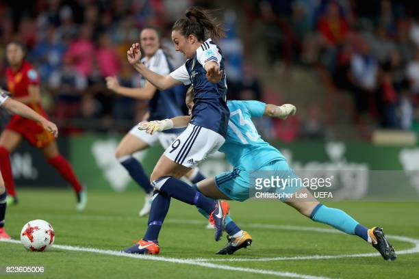 Caroline Weir of Scotland attempts to take the ball past Sandra Panos of Spain and later scores her sides first goal during the Group D match between...