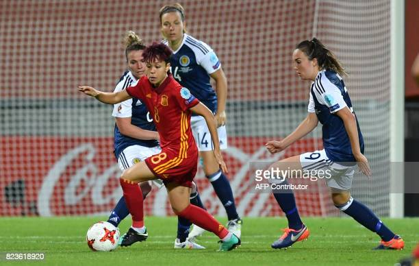 Caroline Weir of Scotland vies with Amanda Sampedro of Spain during the UEFA Women's Euro 2017 football match between Scotland and Spain at De...
