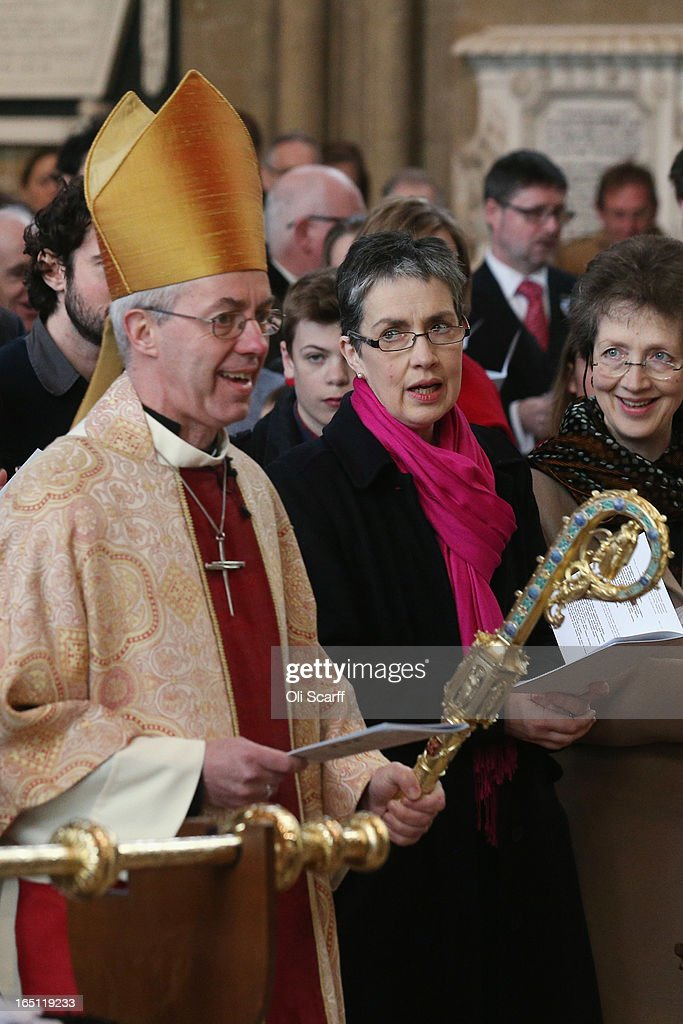 Caroline Welby (C), the wife of The Most Rev and Rt Hon <a gi-track='captionPersonalityLinkClicked' href=/galleries/search?phrase=Justin+Welby&family=editorial&specificpeople=9960447 ng-click='$event.stopPropagation()'>Justin Welby</a> (L), the Lord Archbishop of Canterbury, watches her husband enter Canterbury Cathedral to lead the Easter Sunday service on March 31, 2013 in Canterbury, England. <a gi-track='captionPersonalityLinkClicked' href=/galleries/search?phrase=Justin+Welby&family=editorial&specificpeople=9960447 ng-click='$event.stopPropagation()'>Justin Welby</a> was enthroned on March 21, 2013 as the 105th Archbishop of Canterbury and head of the Church of England.