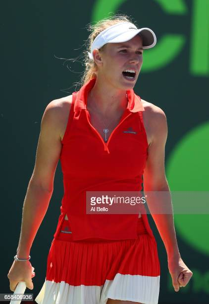Caroline Wosniacki of Denmark reacts against Garbine Muguruza of Spain during Day 8 of the Miami Open at Crandon Park Tennis Center on March 27 2017...