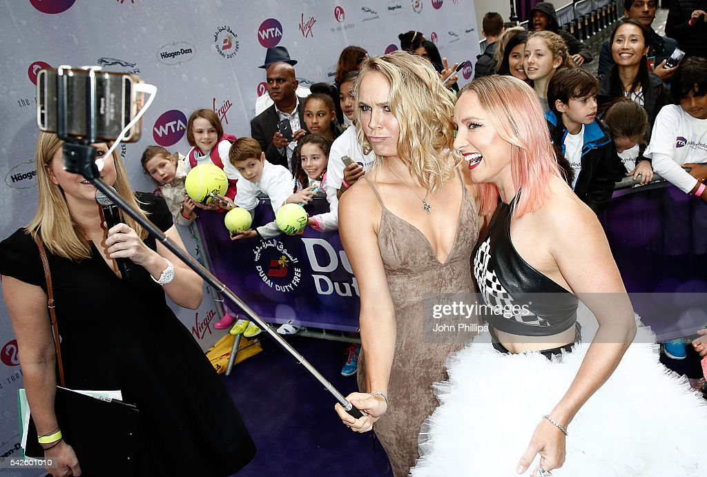 Caroline Wozniacki (L) and Bethanie Mattek-Sands attend the annual WTA Pre-Wimbledon Party presented by Dubai Duty Free at the Kensington Roof Gardens on June 23, 2016 in London, England.