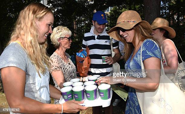 Caroline Wozniacki and Judy Murray serve Lavazza coffee to the queue at Wimbledon on July 1 2015 in London England