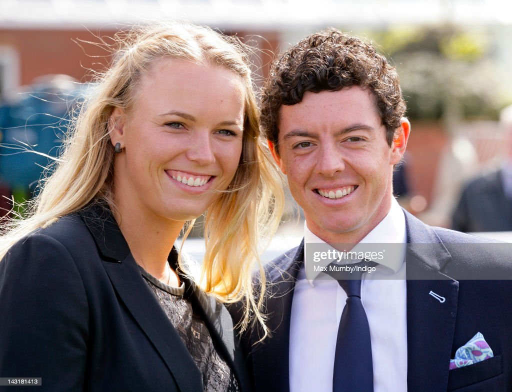 <a gi-track='captionPersonalityLinkClicked' href=/galleries/search?phrase=Caroline+Wozniacki&family=editorial&specificpeople=740679 ng-click='$event.stopPropagation()'>Caroline Wozniacki</a> and Rory McIlroy attend the Dubai Duty Free Race Day at Newbury Racecourse on April 20, 2012 in Newbury, England.