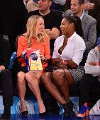 Caroline Wozniacki and Serena Williams attend the Washington Wizards Vs New York Knicks game at Madison Square Garden on November 4 2014 in New York...