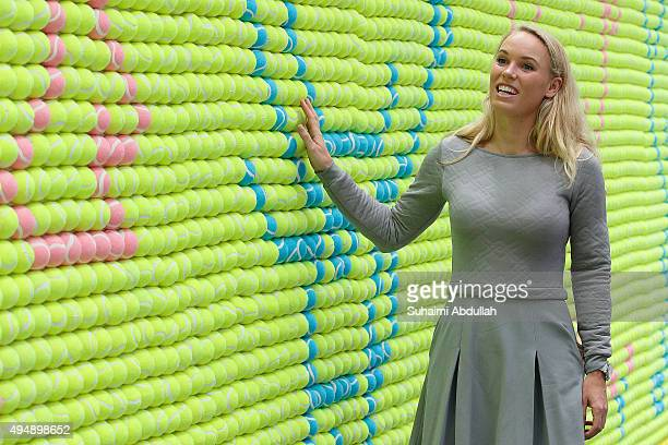 Caroline Wozniacki looks at the largest tennis ball mosaic by Mundipharma at Asia Square on October 30 2015 in Singapore The Guinness World Records...