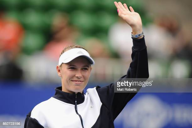 Caroline Wozniacki of Denmark acknowledges the crowd after defeating Anastasia Pavlyuchenkova of Russia in the women's singles final match on day...
